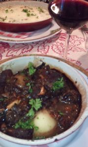 Coq au vin served with a glass of Bordeaux wine