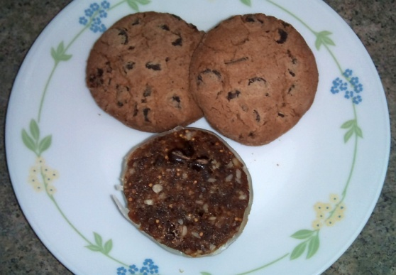 Two chocolate chip cookies and a slice of salami