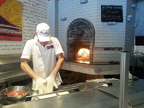 Preparing pizza at The Bibo
