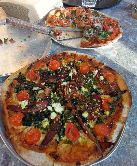 Rocky Mountain Flatbread Veggie Farmers Market pizza (front) and Naturally Meaty pizza (back)