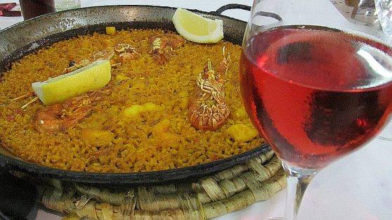 Paella mariscos and a glass of rosado wine