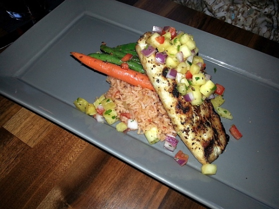 Char broiled Mahi Mahi with southern rice pilaf, market vegetables, and fresh pineapple salsa