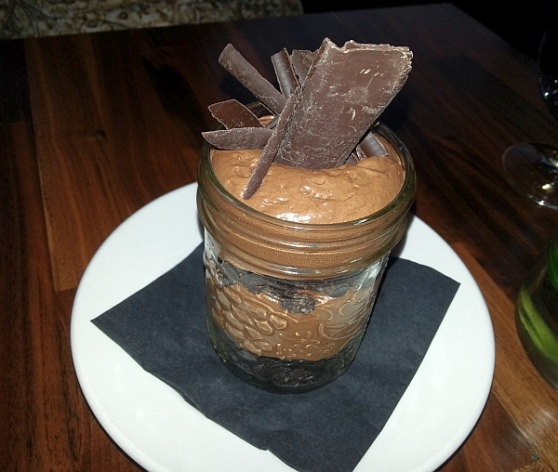 Dark Chocolate Mousse in a jar with oreo cookies and shaved chocolate