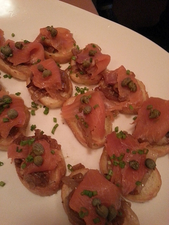 Smoked salmon with caramelized onions on crostini